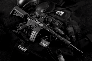 grayscale photo of black m4a1 on magazines